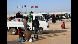 The Latest: Turkey aiding Syrians, but border closed
