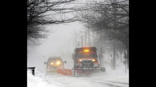 The Latest: Mid-Atlantic region wakes up to snow, rain mix