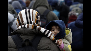 The Latest: Germany OKs some refugee kids bringing families