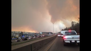 Alberta declares emergency as fires threaten Canada oil town