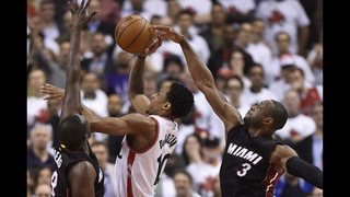 Wade, Heat beat Raptors in OT after Lowry