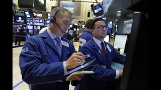 Weak US hiring report sends stocks lower on Wall Street
