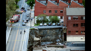 Retaining wall, parking lot collapse onto businesses below