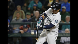 Martin homers in 9th, Mariners rally to beat A