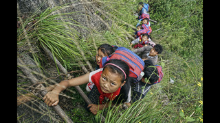 Village where children climb cliffside ladder may get stairs