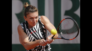 The Latest: Halep pushes Osaka to 3rd set at French Open