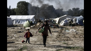 The Latest: IOM eyes closer ties to UN to help migrants