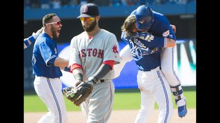 Blue Jays walk off Red Sox, 10-9, as Travis scores Martin
