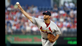 Wainwright uses arm, bat to lift Cardinals past Nats 9-4
