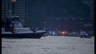 The Latest: WWII plane in fatal crash pulled from river