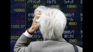 Global shares mixed; Japan tax hike delay plan buoys Asia