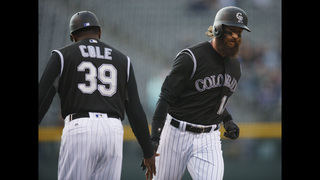 Rockies tie franchise record with 7 homers, beat Reds 17-4