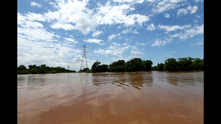 Swollen river feeds flooding near Houston as residents flee