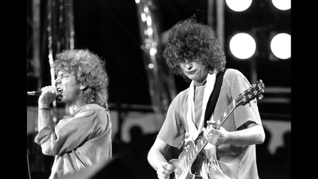 Led Zeppelin's Page dodges court questions, riffs air guitar