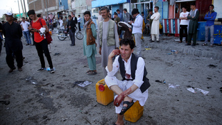 The Latest: Afghan official: Bombing death toll rises to 61