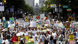 DNC starts in Philadelphia with huge protests, high temps
