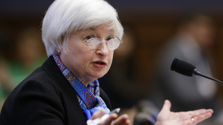 Fed keeps rates steady but sees less risk to US economy