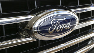 Ford surprises with lower 2Q profit on trouble in US, China