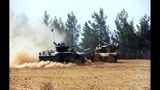 The Latest: Turkish tanks enter Syria in anti-IS operation