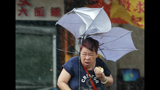 Strong winds from island-wide typhoon kill 4 in Taiwan