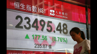 Asian stocks mixed as traders follow US presidential debate