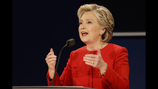 Clinton vows to retaliate against foreign hackers
