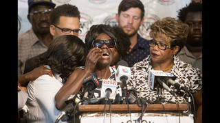 Mother of black man shot by police speaks of her anguish