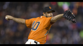 Bumgarner pitches, hits as Giants win; Pagan body-slams fan