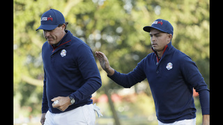 The Latest: Fowler-Mickelson vs. McIlroy-Pieters is tight