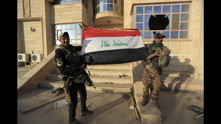 The Latest: Iraqi army says town near Mosul taken from IS