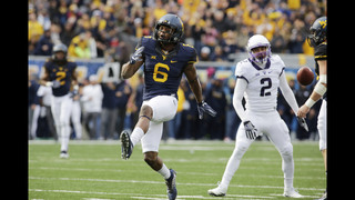 Howard throws 4 TDs, No. 12 West Virginia stomps TCU 34-10