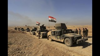 The Latest: Iraq says it repelled IS attack on western town