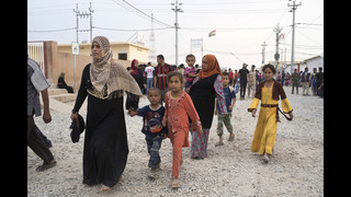 The Latest: Dozens of Iraqis evacuated from IS-free village