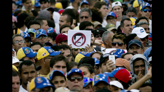 Opposition, socialist supporters face off in Caracas