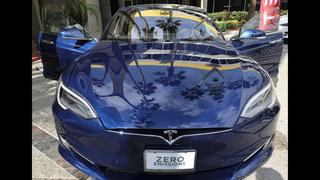 Tesla Motors surprises with 3rd-quarter profit