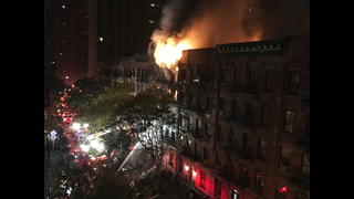 NYC firefighter stages dramatic rescue in fatal blaze