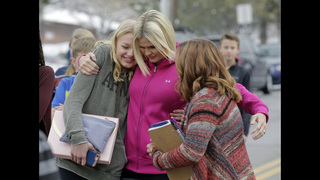 Police hail parents who found, disarmed son at Utah school