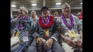 The Latest: Guests observe moment of silence at Pearl Harbor