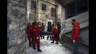 Syrian troops shell crumbling rebel enclave in Aleppo
