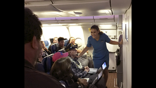 Pearl Harbor veteran honored with inflight hula, song