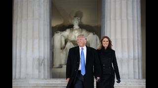 Promises, subdued pomp and protests as Trump sworn in