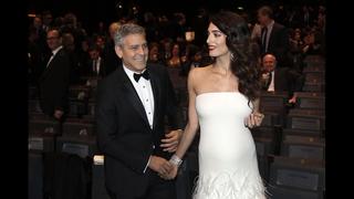 Clooney, in Paris, jokes about Trump