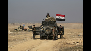 The Latest: Iraqi air force strikes IS targets inside Syria