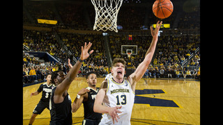 Wagner leads Michigan over No. 14 Purdue 82-70