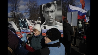 Russians march to remember slain opposition leader Nemtsov