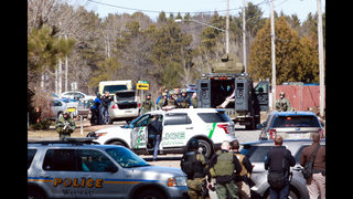 The Latest: Suspect in Wisconsin shootings hospitalized