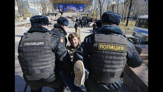 Wave of corruption protests sweeps Russia; Navalny arrested
