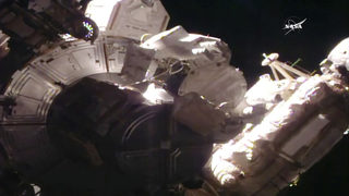 The Latest: Spacewalking astronauts lose piece of shielding