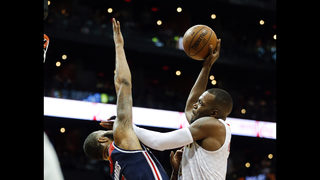 Hawks deliver early playoff KO, romp past Wizards 116-98
