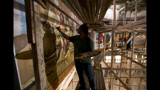 Egyptian artist paints church murals, unfazed by attacks